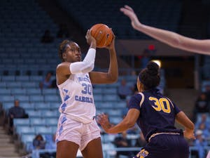 Junior center Janelle Bailey (30) passes ball in the women's basketball game against Navy in the Carmichael Arena on Monday, Nov. 11, 2019. UNC won 80-40.