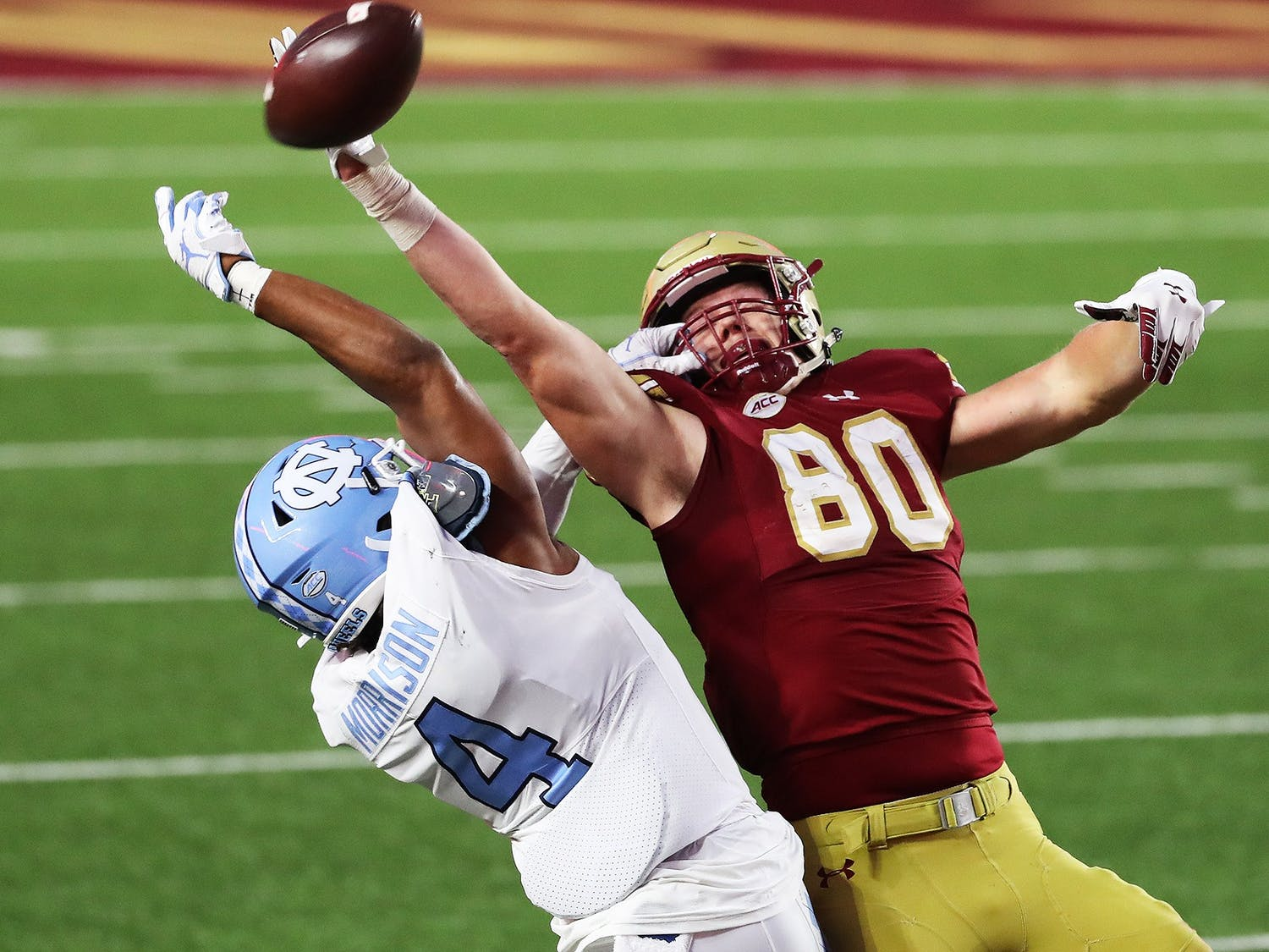UNC junior defensive back Trey Morrison (4) attempts to block a pass to Boston College redshirt junior tight end Hunter Long (80) during a game on Saturday, Oct. 3, 2020. UNC beat Boston College 26-22. Photo courtesy of ACC Media.