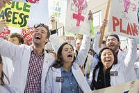 A group of UNC medical students protest against the repeal of the Affordable Care Act at the 11th HKonJ march in Raleigh on February 11th. There is concern about the impact of the repeal on mental health; UNC Rex is opening a mental health center in Raleigh.