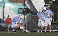 The North Carolina men's lacrosse team shows emotion after losing to No.1 Syracuse 12-11in overtime on Saturday.