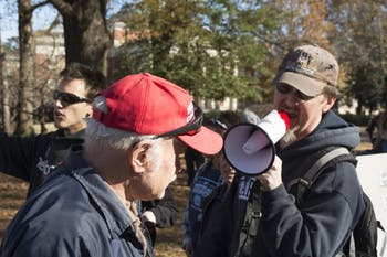A counter protestor shouts at a supporter of Silent Sam through a megaphone during a confrontation in McCorkle Place.