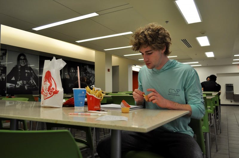 Noah Shore eats lunch on Saturday afternoon at Wendy's.