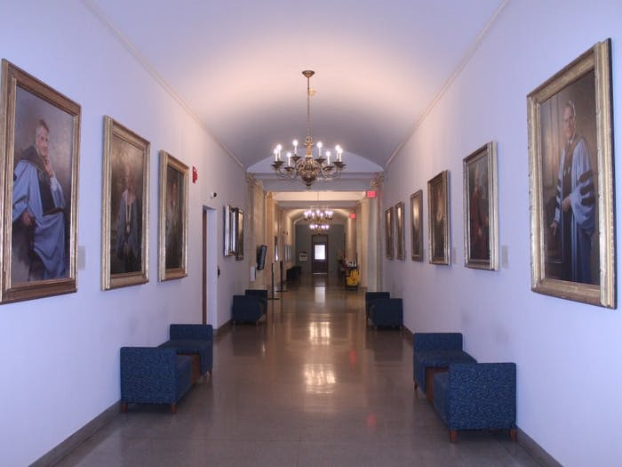 Portraits of former UNC chancellors line the walls of Wilson Library on the campus of the University of North Carolina at Chapel Hill.