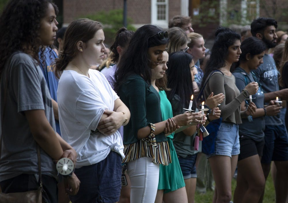 Candlelight vigil held in honor of UNC-Charlotte victims on Polk Place
