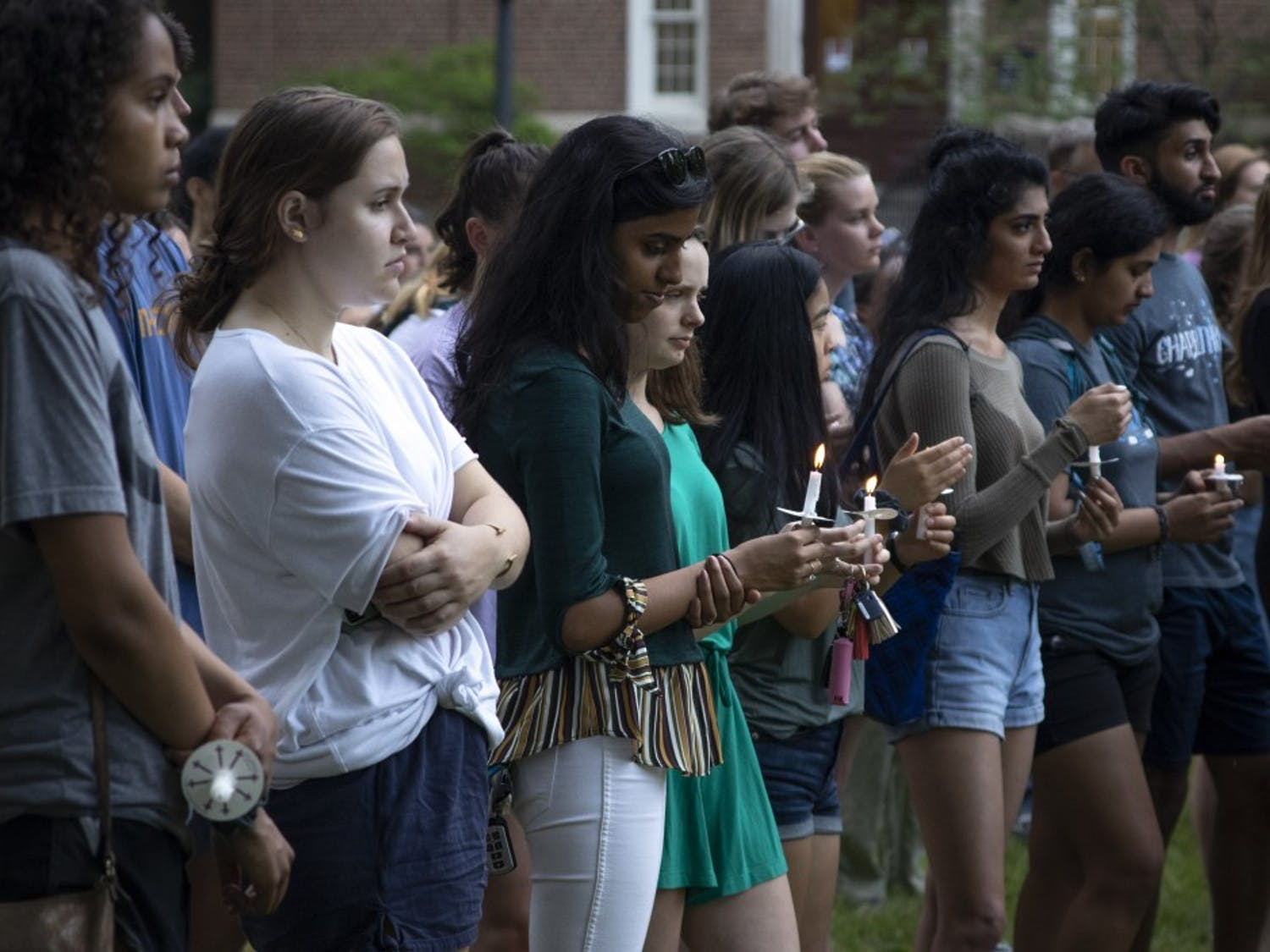 Students and community members gathered on Polk Place Friday evening for a candlelight vigil held in response to the shooting that occurred at UNC Charlotte Tuesday.