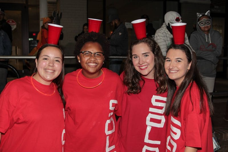 "UNC students Emily Lawson, Isabella Ponder, Anna Wagoner and Grace Smith on Franklin Street as a game of ""Beer Pong."""