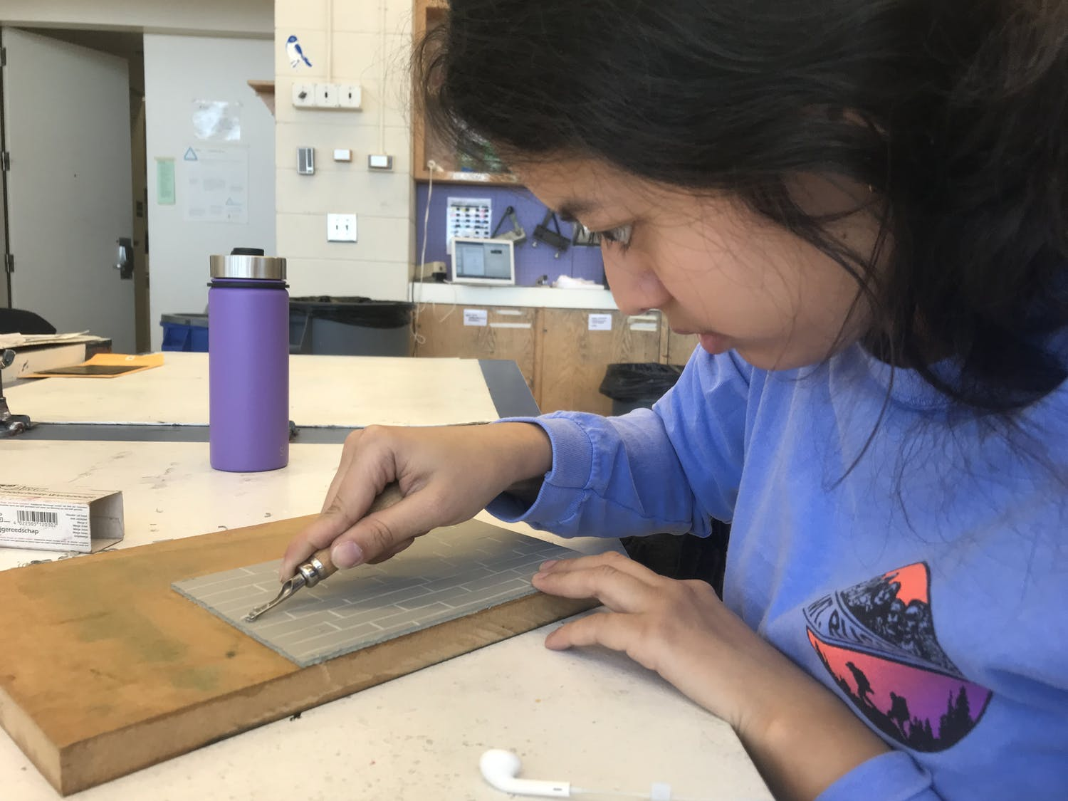 Kylee Barrera, a student in ARTS 358: Letterpress, carves linoleum for her indulgence project on Wednesday, Feb. 26, 2020.