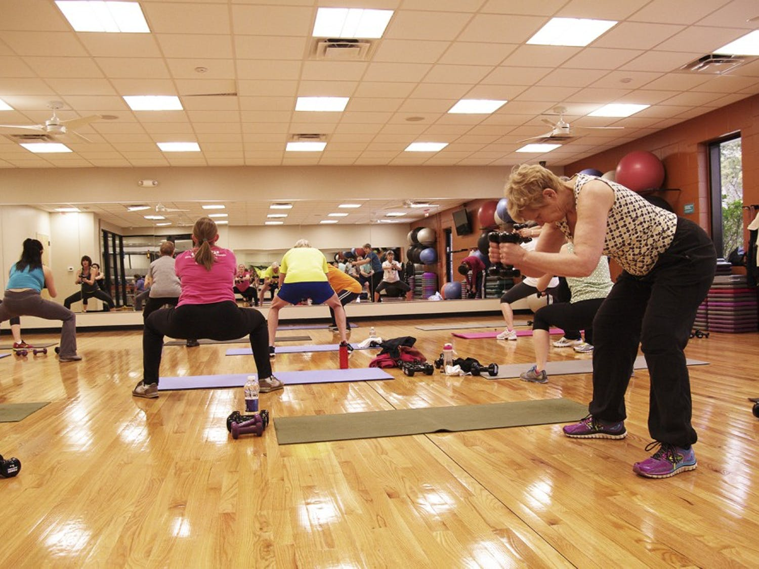 YMCA members attend a total body strength class in the main studio on March 23.