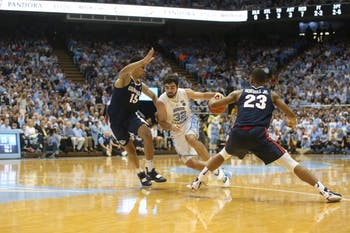 UNC forward Luke Maye (32) breaks away through the Gonzaga defense in a game at the Dean Dome on Saturday night. UNC won 103 - 90.