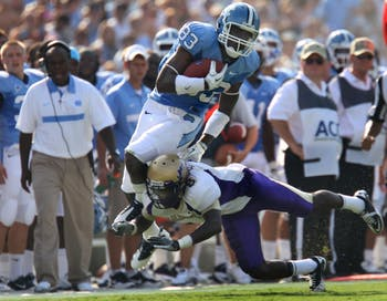 UNC wide receiver Dwight Jones (83) has his feet knocked out from under him in the game against James Madison on Saturday. UNC defeated JMU 42-10.
