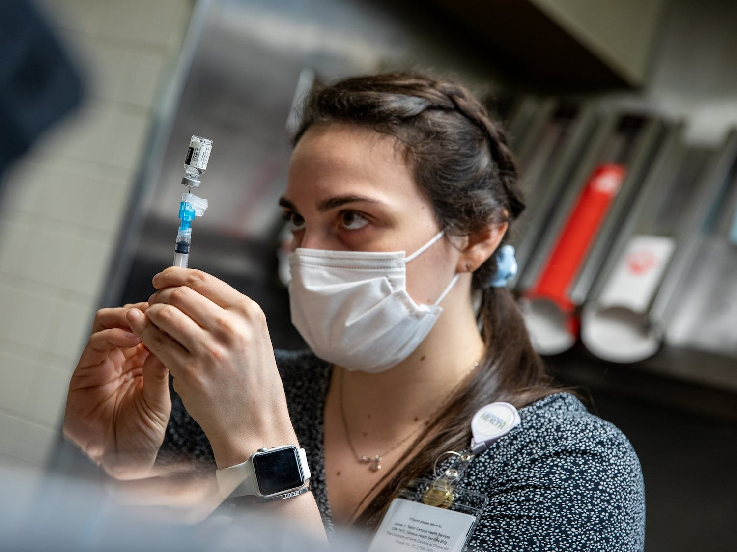 A UNC pharmacist prepares a vaccine dose in the former Wendy's in the Student Union on March 31, 2021. As North Carolina began to allow college students to receive coronavirus vaccines, UNC opened a clinic on campus where students can receive the Johnson & Johnson vaccine.