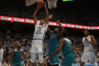 Graduate guard Cameron Johnson (13) goes for a layup during the game against UNCW Wednesday, Dec. 5, 2018 in the Smith Center. UNC won 97-69.