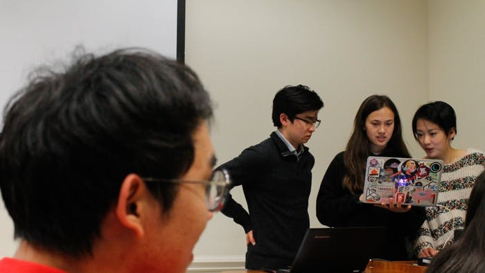 (From left to right) Political committee member Daniel Kang, President Anna Hattle and Senior Advisor Jessie Huang of the Asian American Student Association prepare to address the members of the organization in Bingham Hall on Thursday, Feb. 28, 2019.