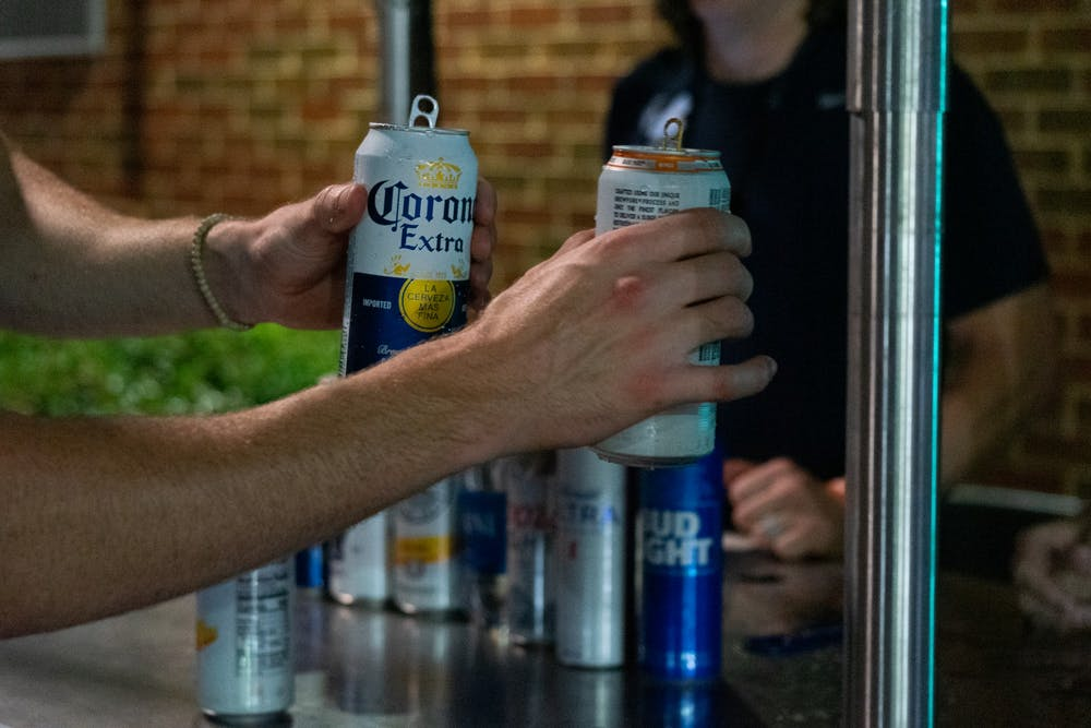 <p>DTH Photo Illustration. A vendor sells two alcoholic beverages to a customer during a UNC football game at Kenan Stadium on Sept. 18, 2021.&nbsp;</p>