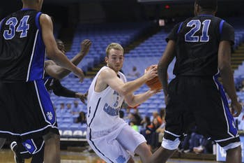 Harrison Lancaster (5) swerves between Central Carolina Community College players Saturday afternoon at the Dean Smith Center.