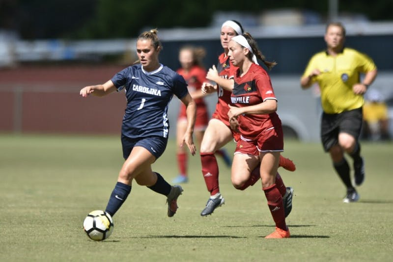 Junior forward Madison Schultz outruns Louisville defenders during a 5-1 win over the Cardinals on Sept. 29, 2018.