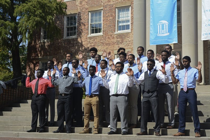 UNC students gathered in front of South Building to take the 100 Black Men in Suits Challenge. It is a challenge that's been taken on at colleges across the country to give a new image to black men. The men pose in suits for a phototo fight stereotypes of black men.