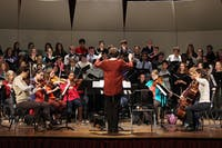 """The UNC choir and orchestra rehearsed """"Isaiah,"""" a piece written by Stephen Anderson in Hill Hall on Wednesday. Anderson was commissioned by the Mormon Artist group to write the piece. """"Isaiah"""" will be performed on Thursday, November 21 at 8 p.m. in Hill Hall Auditorium."""