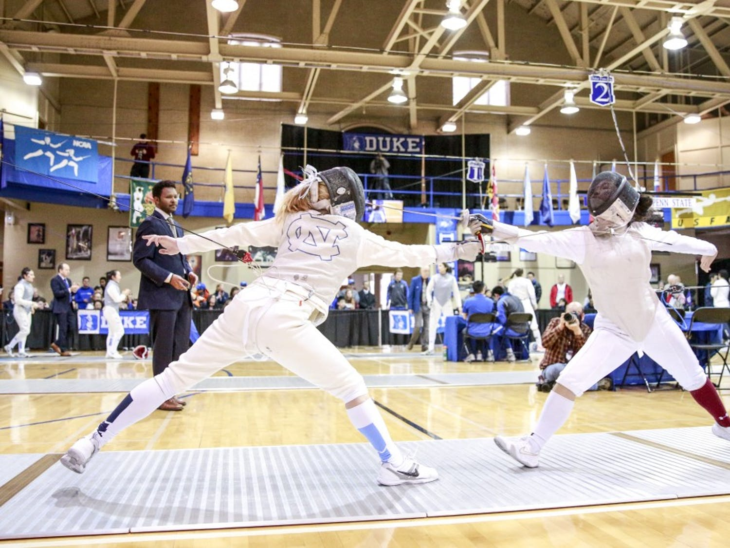 UNC's Sydney Persing fences with Boston College's Vivian Li during the women's fencing match in Card Gym at Duke University on Sunday, Feb. 10, 2018.