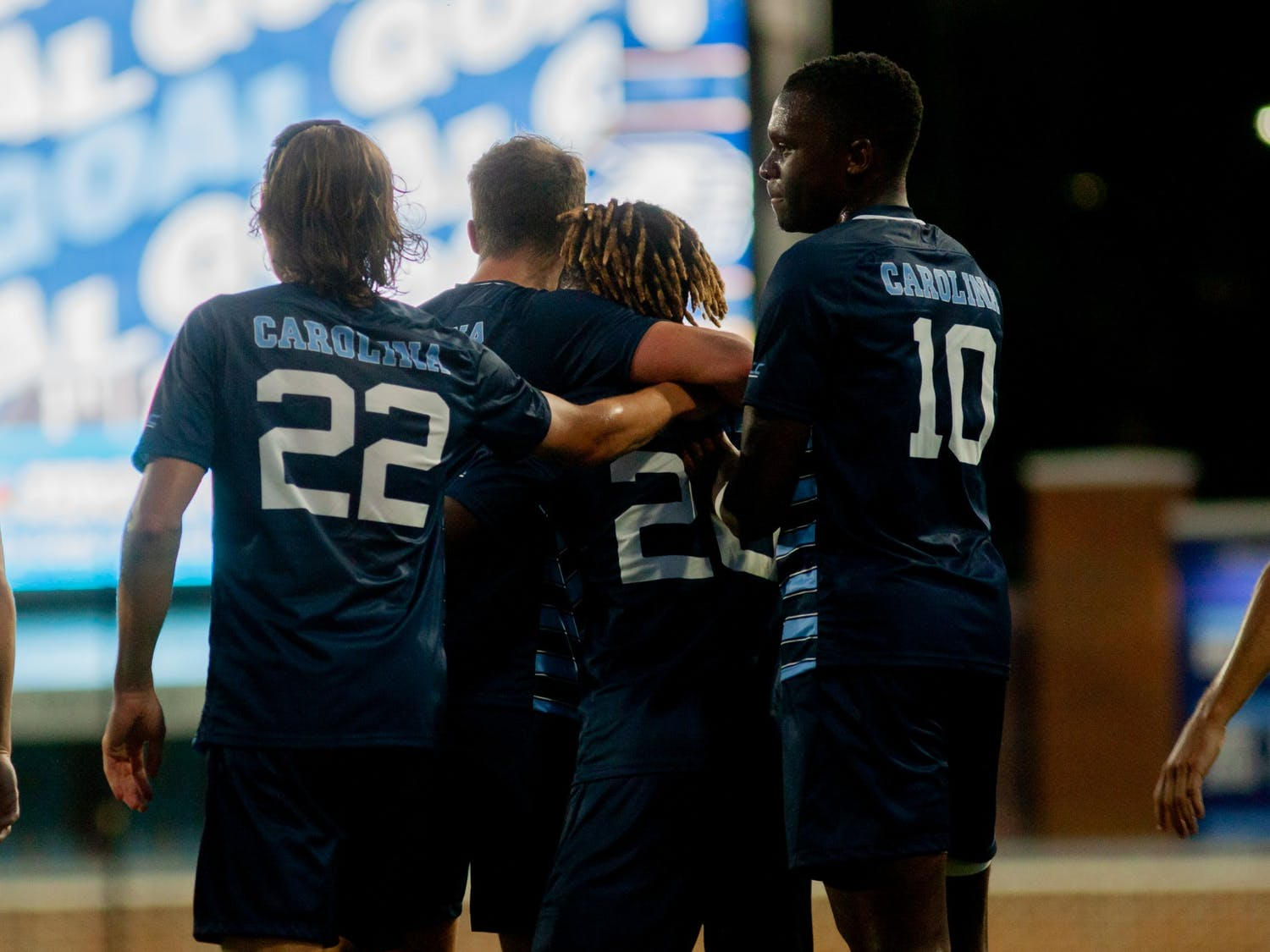 The UNC Tar Heels embrace after junior midfielder Cameron Fisher (17) scores the third goal of the game with an assist from midfielder/forward Ernest Bawa (20). The Tar Heels beat the Georgia Southern Eagles 3-0 at Dorrance Field on Sept. 3.
