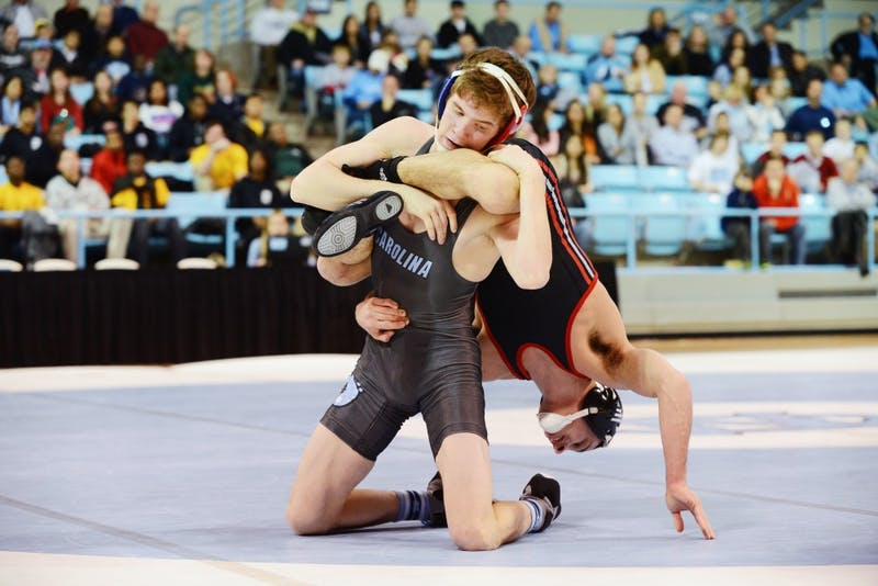 UNC Freshman Nathan Kraisser defeats NC State Junior Joe DeAngelo 8-3 in the 125 pound bout.