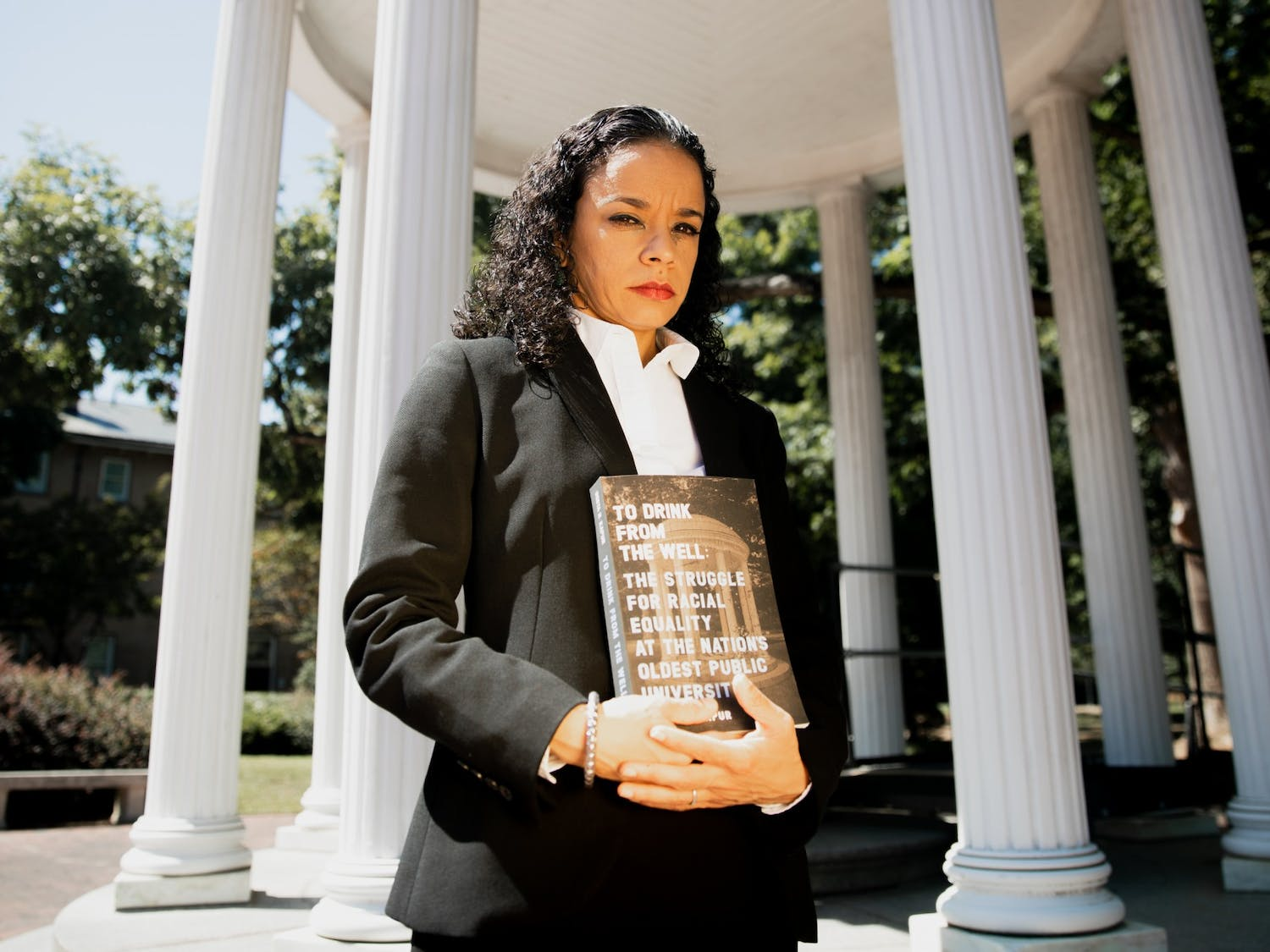 """""""It's been that way since the very beginning,"""" says Geeta Kapur of the systemic racism at UNC. Kapur poses for a portrait at the Old Well with her new book, """"To Drink from the Well: The Struggle for Racial Equality at the Nation's Oldest University,"""" on Tuesday, Sep 7., 2021."""