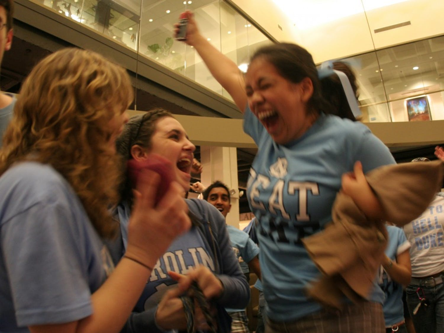 Maria Diaz reacts at the end of the Duke game on Wednesday night. Diaz was one of a crowd of students who cheered on the Heels in the Union lobby.