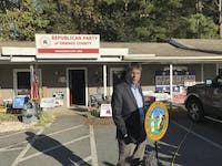 Governor Pat McCrory stands outside the Hillsborough GOP office during his campaign for re-election on October 17.
