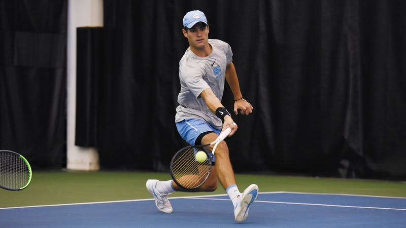 Ladd Harrison swings during a match against NCCU at the Cone-Kenfield Tennis Center on Saturday, Jan. 18, 2020. Photo courtesy of Rebecca Lawson/GoHeels.
