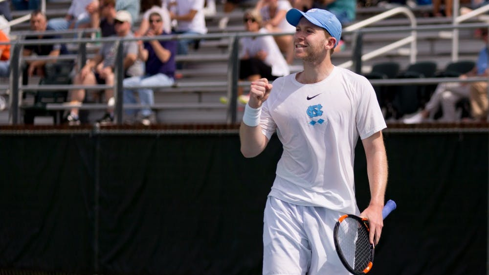 <p>Sophomore Simon Soendergaard celebrates during an Sunday, April 1, 2018 match against Virginia at the Cone-Kenfield Tennis Center.</p>