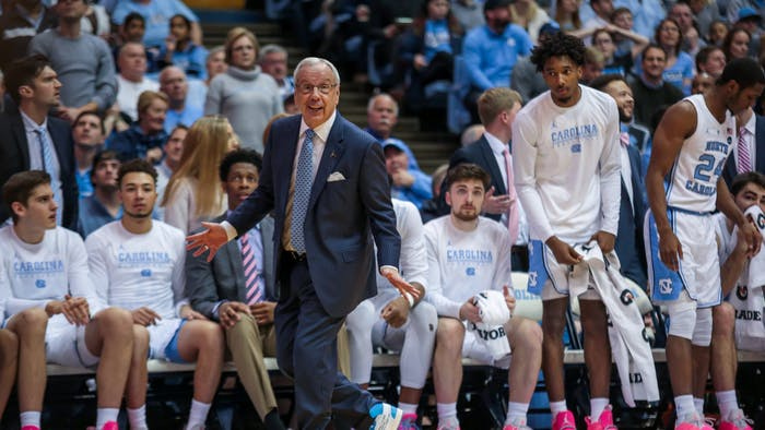 """Roy Williams participated in """"Suits and Sneakers week"""" by wearing a special suit, tie and sneakers to the Virginia Tech game raise cancer awareness."""