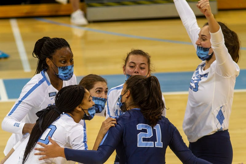 Players on the UNC Womens Volleyball team celebrate during their game against Virginia on Saturday Oct. 31 at Carmichael Arena. The Tar Heels won 3-1.