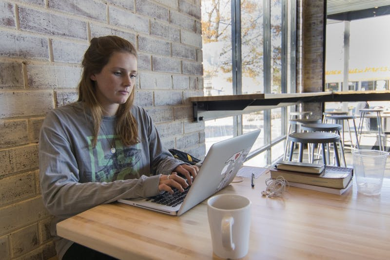 "Courtney Beals, senior at UNC, loves to study at Gray Squirrel Coffee. ""They have big windows, a lot of natural lights and their coffees are relatively cheap,"" said Beals."