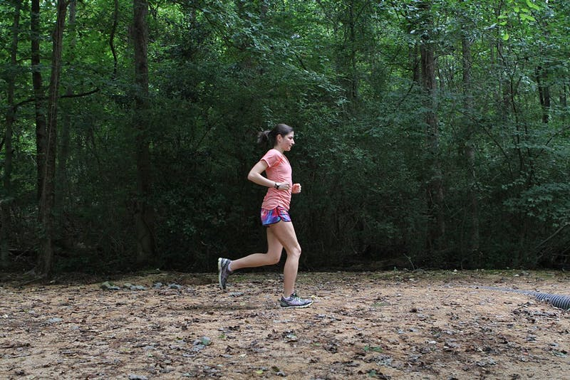 Mariana Lucena runs at the UNC Cross Country Course at Finley Fields.
