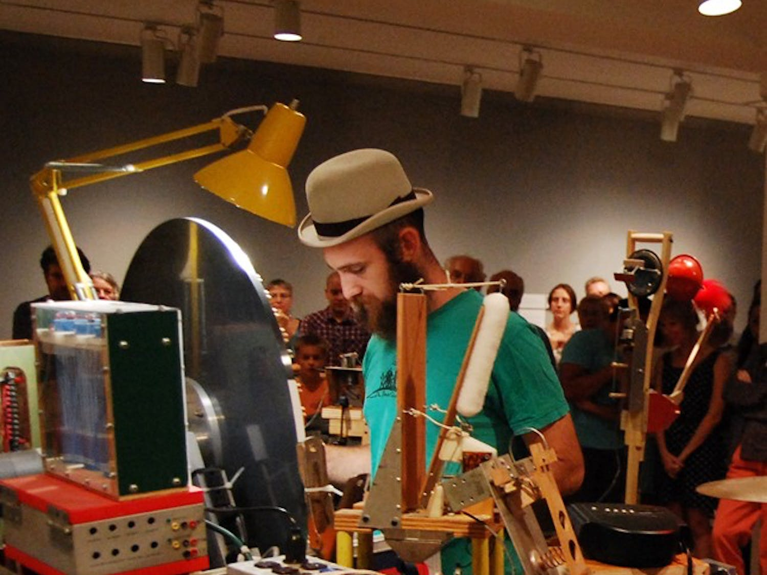 Mark Dixon of the alternative home-made music project INVISIBLE performs for a crowd at Ackland Art Museum on Thursday night.