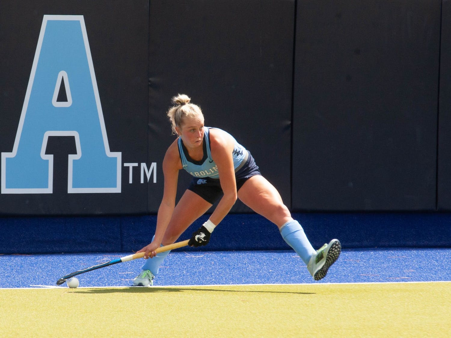 UNC junior midfielder Paityn Wirth (10) passes the ball during the field hockey game against the Miami Redhawks at Karen Shelton Stadium on Sept. 19, 2021. The Tar Heels defeated the Redhawks 7-2.