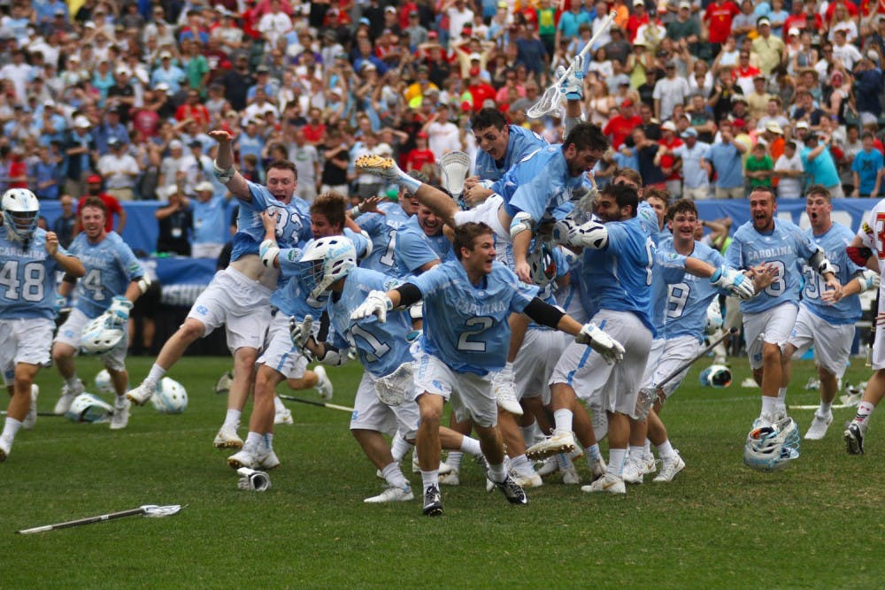 <p>The North Carolina men's lacrosse team celebrates after defeating Maryland 14-13 in overtime to capture the program's first national championship since 1993 on Monday at Lincoln Financial Field in Philadelphia.</p>