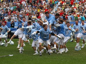 The North Carolina men's lacrosse team celebrates after defeating Maryland 14-13 in overtime to capture the program's first national championship since 1993 on Monday at Lincoln Financial Field in Philadelphia.