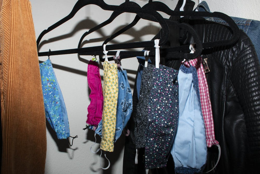 <p>DTH Photo Illustration depicting face masks hanging in a student's closet. Face coverings have become an integral part of 2020's stylebook, and people are taking creative and innovative approaches to how they are worn and used as fashion statements.</p>