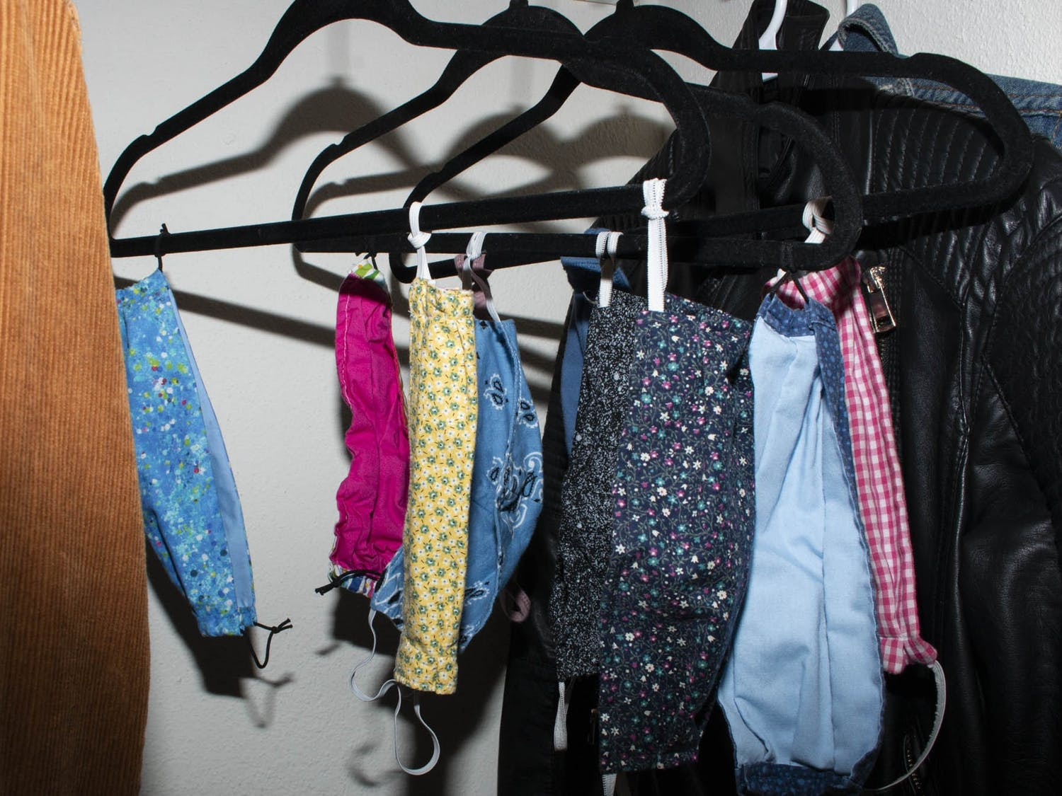 DTH Photo Illustration depicting face masks hanging in a student's closet. Face coverings have become an integral part of 2020's stylebook, and people are taking creative and innovative approaches to how they are worn and used as fashion statements.