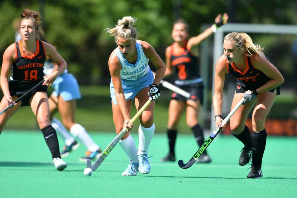 <p>First-year midfielder Jasmina Smolenaars (22) goes for the ball in a field hockey game against Princeton on Sept. 5. Photo courtesy of Greg Carroccio/Princeton Athletics.&nbsp;</p>