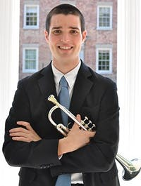 """John Parker, a senior at UNC, had his world flip upside down the weekend of October 7, 2013, when he earned the position of principal trumpet in the Charlotte Symphony Orchestra. Parker beat nearly 100 other musicians who were invited to audition for the position, which he will take after this semester. Parker has played trumpet since he was 10, saying, """"It's fun picking up the horn every day and experiencing something different."""""""