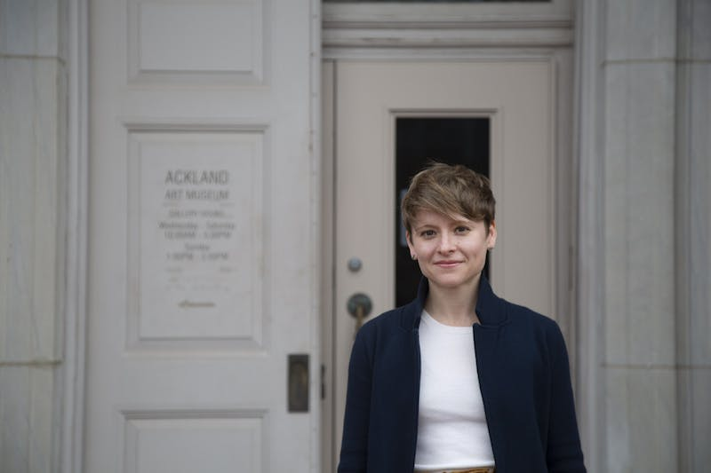 """Brantly Moore, an object-based teaching fellow, poses in front of the Ackland Art Museum on Monday, Feb. 10, 2020. """"I work with faculty all over campus to connect the museum's collections to their course content for graduates and undergrads,"""" Moore said."""