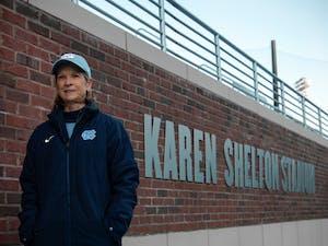 Karen Shelton poses inside Karen Shelton Stadium in Chapel Hill, N.C. on January 28, 2019. Shelton has coached the North Carolina field hockey team since 1981. Under Shelton, the Tar Heels won eight NCAA Championships and in 2018, UNC named its new field hockey stadium in her honor. Photo courtesy of Will Melfi UNC MEDIA HUB