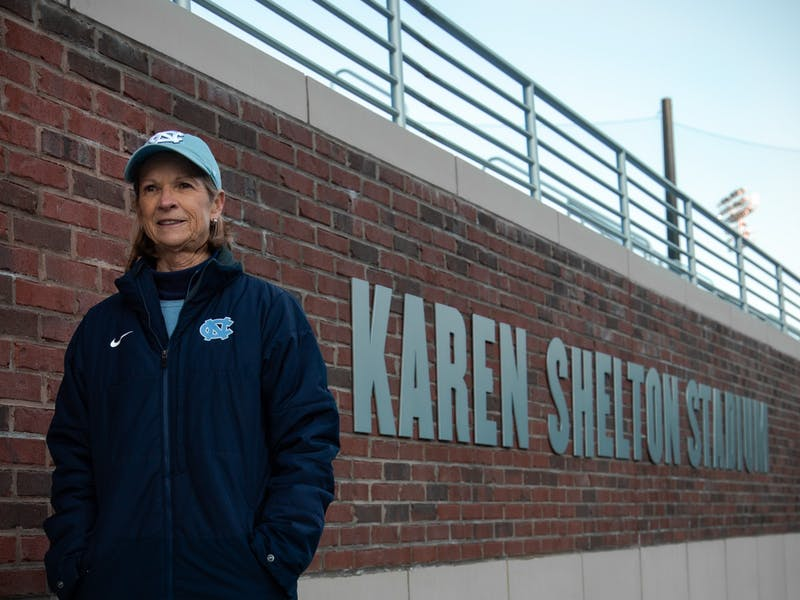 Karen Shelton poses inside Karen Shelton Stadium in Chapel Hill, N.C. on January 28, 2019. Shelton has coached the North Carolina field hockey team since 1981. Under Shelton, the Tar Heels won eight NCAA Championships and in 2018, UNC named its new field hockey stadium in her honor. Photo courtesy of Will Melfi UNC MEDIA HUB