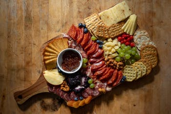DTH Photo Illustration. Charcuterie boards are the latest COVID-19 culinary craze to sweep college campuses due to their ease of assembly and trendy aesthetic.