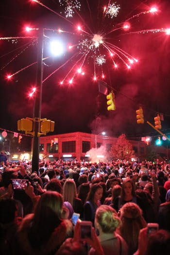 UNC fans celebrate with fireworks at bonfire in the middle of Franklin Street after the UNC Men's Basketball win over Duke on Thursday.