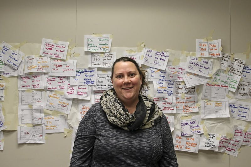 Corey Root is the Homeless Program coordinator for Orange County. Behind her is a wall covered in different cases of people she plans to enter into the system.