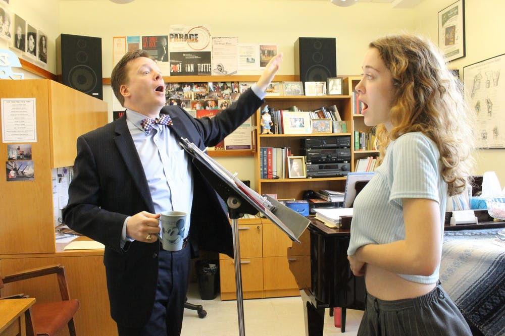 <p>Professor Timothy Sparks sings with a student in 2015. Photo courtesy of Kelly Archer.</p>