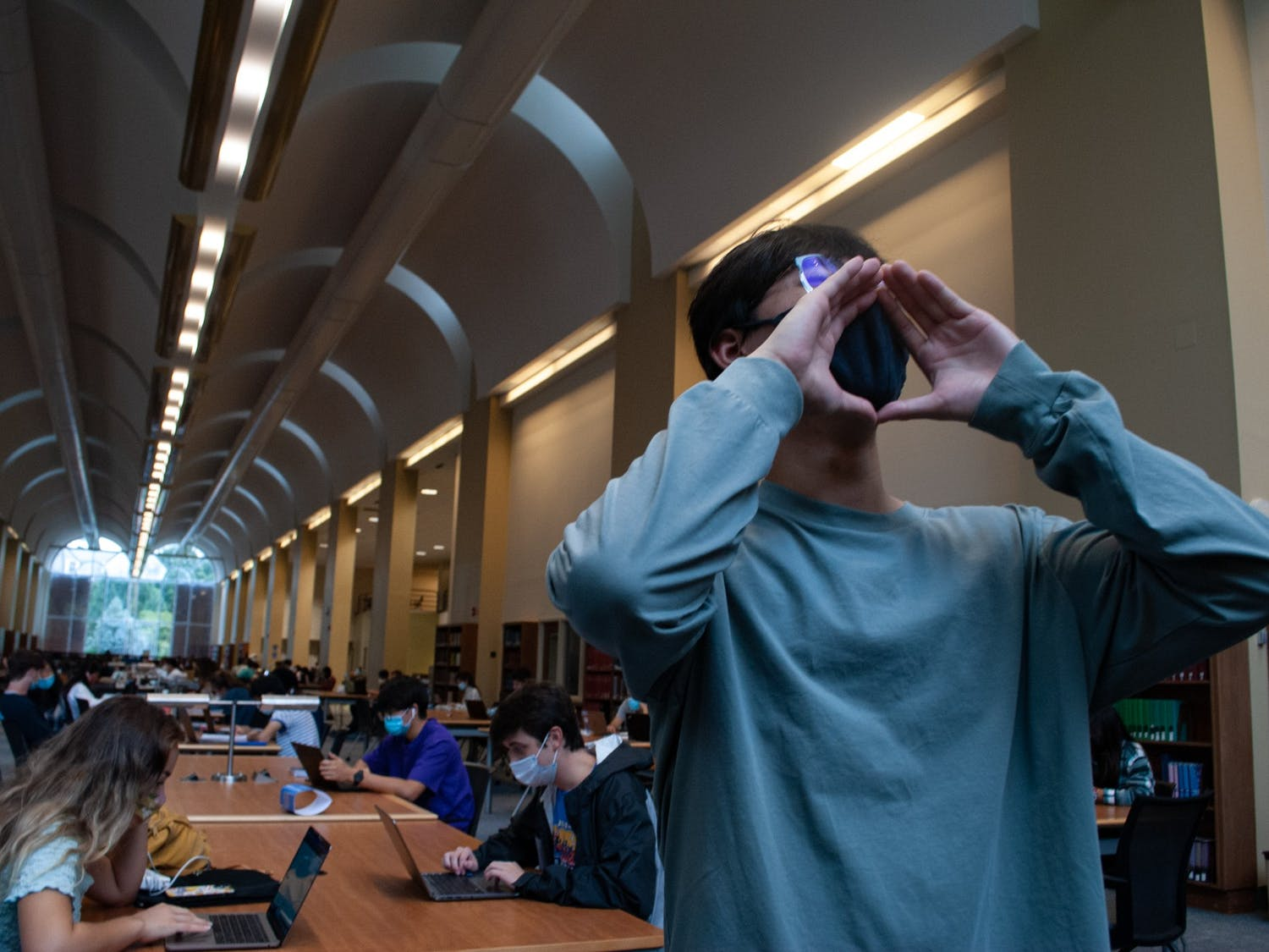 Second year exercise and sports science major Jordan Han causes a ruckus in a quiet first floor of Davis Library. Listening sessions were held on Oct. 7 and Oct. 8 for student to discuss the volume levels in Davis Library.